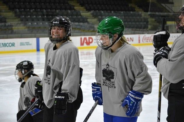 Class of 2021 Cadets Leighton McAlpin (left) and Emily Johnsrud at hockey practice at Tate Rink.