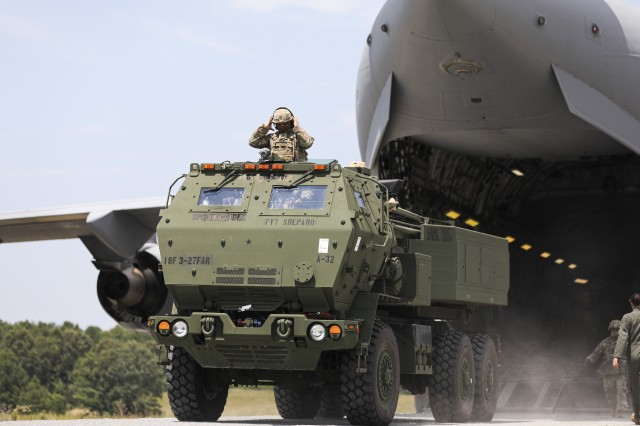 Crewmembers assigned to 3rd Battalion, 27th Field Artillery Regiment (HIMARS), unload a M142 High Mobility Artillery Rocket System, from a C-17 Globemaster III, en route to a simulated firing mission, at Fort A.P. Hill Landing Zone, Virginia, July 20, 2020. These 3-27th FAR (HIMARS) crews are conducting simulated Artillery Raids in preparation for taking on the immediate reaction force (IRF) mission. (U.S. Army Photo by Spc. Daniel J. Alkana, 22nd Mobile Public Affairs Detachment)