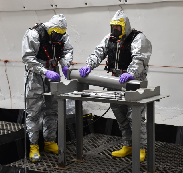 Chemical, Biological, Radiological, Nuclear and Explosives (CBRNE) Analytical and Remediation Activity (CARA) East personnel rehearse the fuze removal process during the pre-operational survey.