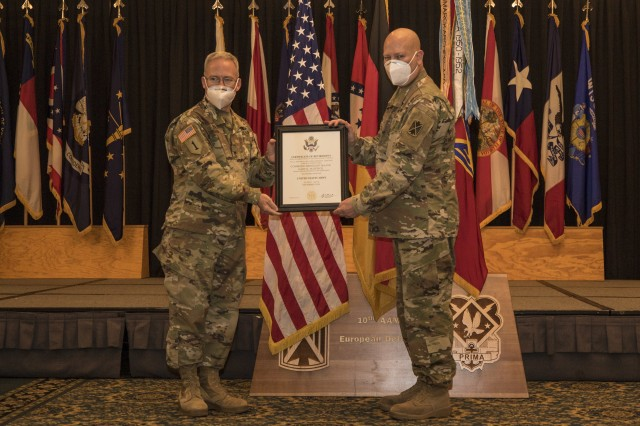 Brig. Gen. Gregory Brady gives Command Sgt. Maj. Gary Plonick a Certificate of Retirement during a10th Army Air and Missile Defense Command Retirement Ceremony on Aug. 6, 2020. at Ramstein Air Base, Germany.