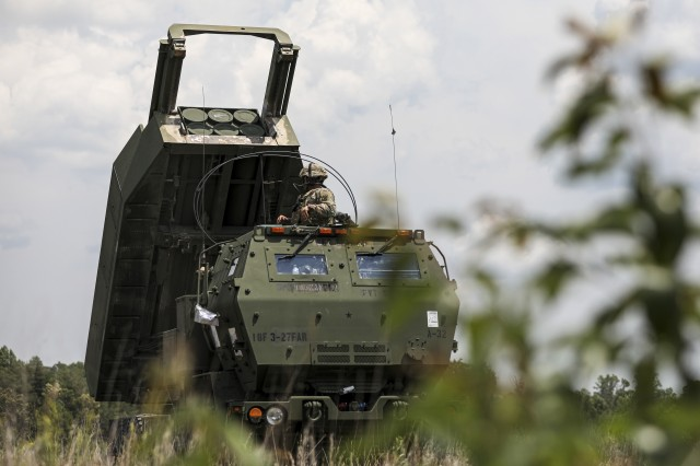 U.S. Army Sgt. Jacob Ramirez, a multiple launch rocket system (MLRS/HIMARS) crewmember, assigned to 3rd Battalion, 27th Field Artillery Regiment (HIMARS), raises a M142 High Mobility Artillery Rocket System, to simulate accuracy of live rounds, at Fort A.P. Hill Landing Zone, Virginia, July 20, 2020. These 3-27th FAR (HIMARS) crews are conducting simulated Artillery Raids in preparation for future large scale combat operations. (U.S. Army Photo by Spc. Daniel J. Alkana, 22nd Mobile Public Affairs Detachment)