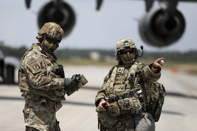 Lt. Col. John Bradley, commander, 3rd Battalion, 27th Field Artillery Regiment (HIMARS), directs personnel after disembarking from a C-17 Globemaster III, in Fort A.P. Hill, Virginia, for an artillery raid exercise on July 20, 2020. Crews from the 3-27th FAR (HIMARS) have been conducting fire missions to enhance readiness in preparation for future large scale operations. (U.S. Army photo by Spc. Daniel J. Alkana, 22nd Mobile Public Affairs Detachment)