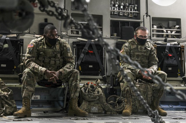 Soldiers assigned to 3rd Battalion, 27th Field Artillery Regiment (HIMARS), wait to disembark  from a C-17 Globemaster III, after arriving at  Fort A.P. Hill Landing Zone, Virginia, for an Artillery Raid, on July 20, 2020. These 3-27th FAR (HIMARS) crews have been conducting fire missions to enhance readiness in preparation for future large scale combat operations. (U.S. Army photo by Spc. Daniel J. Alkana, 22nd Mobile Public Affairs Detachment)