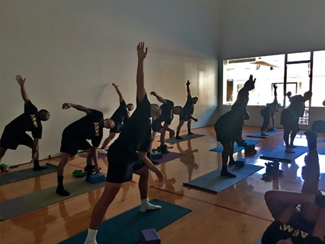 Soldiers assigned to the Soldier Recovery Unit at Schofield Barracks, HI., take a yoga class. The adaptive reconditioning program offers a movement-based yoga practice and a form of yoga nidra called iRest. (U.S. Army courtesy photo)