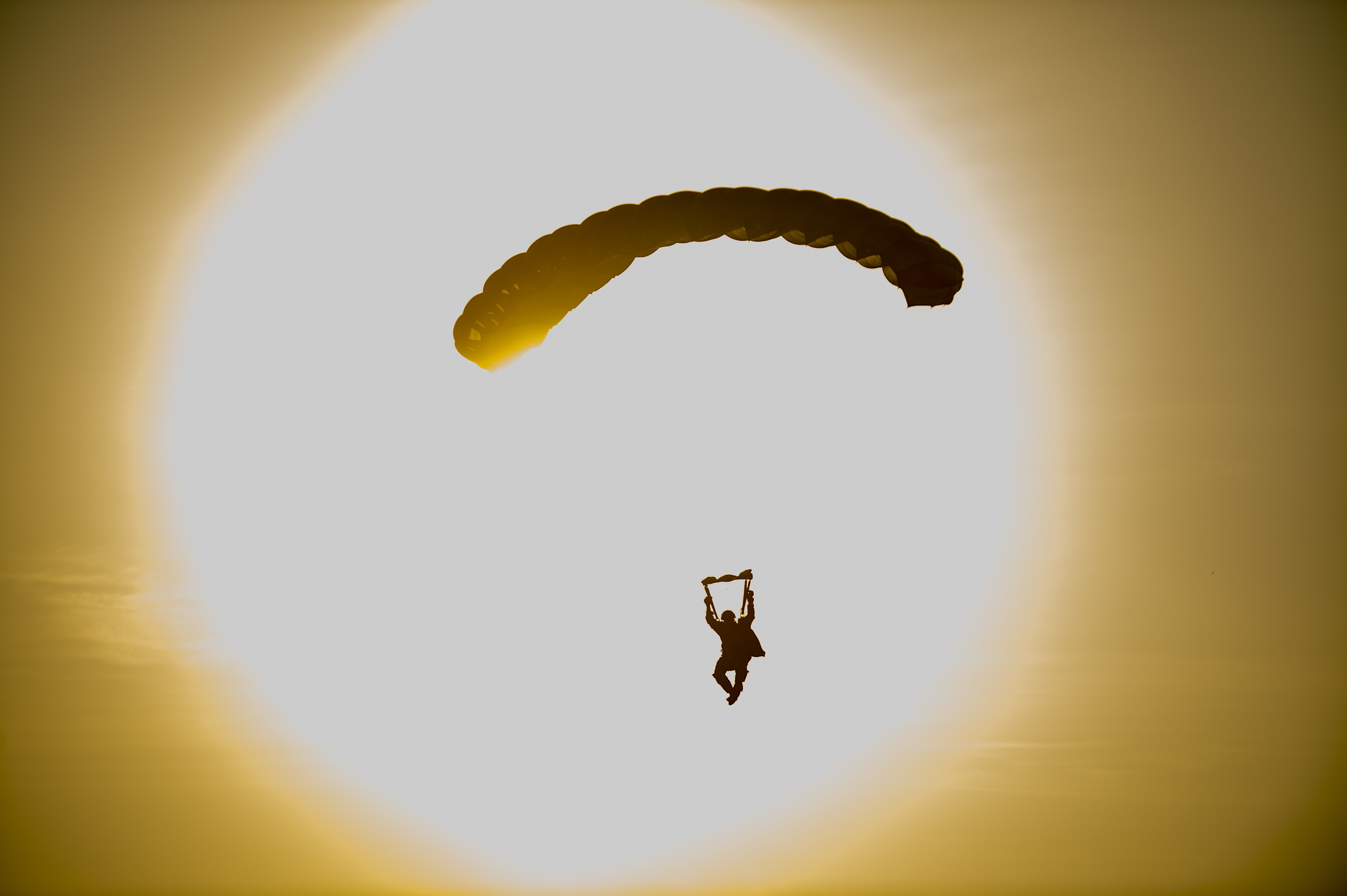 U.S. Army Reserve and active duty Soldiers perform an airborne operations jump from UH-60 Black Hawk helicopters at Fort Bragg, North Carolina, July 17, 2020. Soldiers who are assigned to airborne units must complete a parachute jump every three months to retain jump certification. Soldiers who jumped on this day included members from the U.S. Army Civil Affairs & Psychological Operations Command (Airborne) headquarters, 824th Quartermaster Company, the 478th Civil Affairs Battalion, and 647th Quartermaster Company among other local units at Fort Bragg. (U.S. Army Reserve photo by Master Sgt. Michel Sauret)