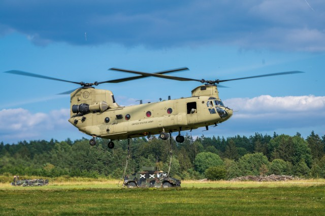 "A CH-47 Chinook from B Co ""Big Windy,"" 1-214th General Support Aviation Battalion lifts a 173rd Airborne Brigade tactical vehicle during Saber Junction 20 at Grafenwöhr Training on Aug. 5. (U.S. Army photo by Maj. Robert Fellingham)"