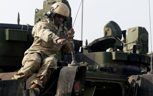Spc. Taylor Norris, a joint fire support specialist with the 1st Battalion, 6th Infantry Regiment, 2nd Brigade Combat team, 1st Armored Division, fixes an antenna to ensure the radios have satellite communication during field preparation for an Emergency Deployment Readiness Exercise at Drawsko Pomorskie Training Area, Poland, March 23. During NetModX 20, the C5ISR Center will collect performance data and validate the non-traditional waveform systems' abilities to meet key performance parameters.