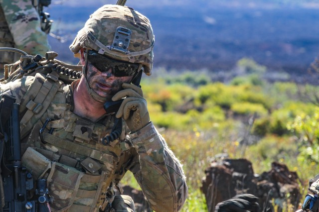 An infantryman from the 1st Battalion, 21st Infantry Regiment, 2nd Infantry Brigade Combat Team, 25th Infantry Division, coordinates fires over the radio during the Fire Support Coordination Exercise (FSCX) on Nov. 15, 2019 at Pohakuloa Training Area, Hawaii. The Army's non-traditional waveforms effort is dedicated to improving communications capabilities in electronic warfare operating environments.