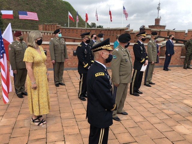 U.S. Army Europe commanding general, Lt. Gen Christopher Cavoli, observes U.S. Army Chief of Staff Gen. James C. McConville and Lt. Gen. John Kolasheskis, V Corps commanding general, officially unfurl the V Corps flag in Krakow, Poland, Aug. 4. The primary mission of V Corps Headquarters (Forward) will be conducting operational planning, mission command oversight of rotational forces in Europe and will provide additional support to allies and partners in the region.