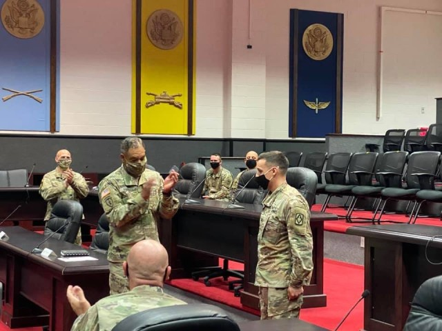 Staff Sgt. Marcus J. Badillo receives a coin and recognition Aug. 11, 2020, from Gen. Michael Garrett, the commanding general of U.S. Army Forces Command, for recent achievements as the FORSCOM NCO of the Year.