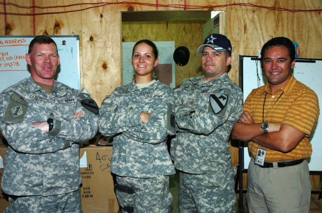 U.S. Army Reserve Sgt. Rachel Copeland (then under her maiden name Ahner) with coworkers during her Iraq deployment in 2007.