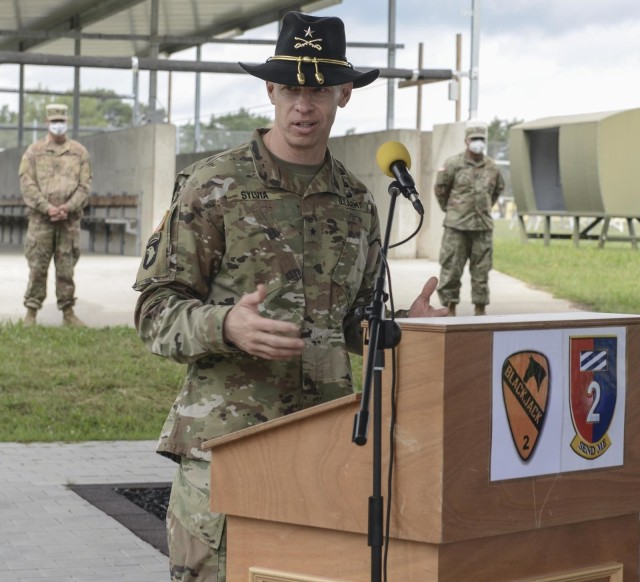 Brig. Gen. Brett Sylvia, 1st Cavalry Division Forward commander, speaks to the formation during a transfer of authority ceremony in Grafenwoehr, Germany, July 2, 2020. The 2nd Armored Brigade Combat Team, 1st Cavalry Division transferred authority to 2nd Armored Brigade Combat Team, 1st Infantry Division. (U.S. Army National Guard photo by Staff Sgt. Noshoba Davis)