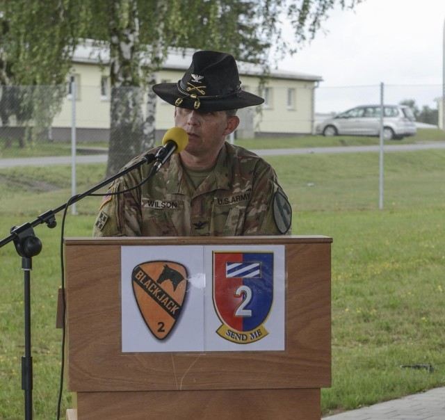 Col. Jeremy Wilson, 2nd Armored Brigade Combat Team, 1st Cavalry Division commander, speaks to the formation during a transfer of authority ceremony in Grafenwoehr, Germany, July 2, 2020. The 2-1CAV transferred authority to 2nd Armored Brigade Combat Team, 1st Infantry Division. (U.S. Army National Guard photo by Staff Sgt. Noshoba Davis)