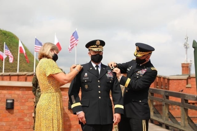 U.S. Army Chief of Staff Gen. James C. McConville pins on Lt. Gen. John Kolasheskis' new rank during his promotion ceremony in Krakow, Poland, Aug. 4. Kolasheski is the new V Corps commanding general. The two went on to unfurl the V Corps flag, officially establishing the V Corps Headquarters (Forward).