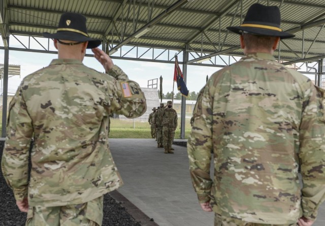 Brig. Gen. Brett Sylvia, 1st Cavalry Division Forward commander, salutes Maj. Alex Wray, the executive officer of 2nd Armored Brigade Combat Team, 1st Infantry Division to end the transfer of authority ceremony in Grafenwoehr, Germany, July 2, 2020. The 2nd Armored Brigade Combat Team, 1st Cavalry Division transferred authority to 2-1ID. (U.S. Army National Guard photo by Staff Sgt. Noshoba Davis)