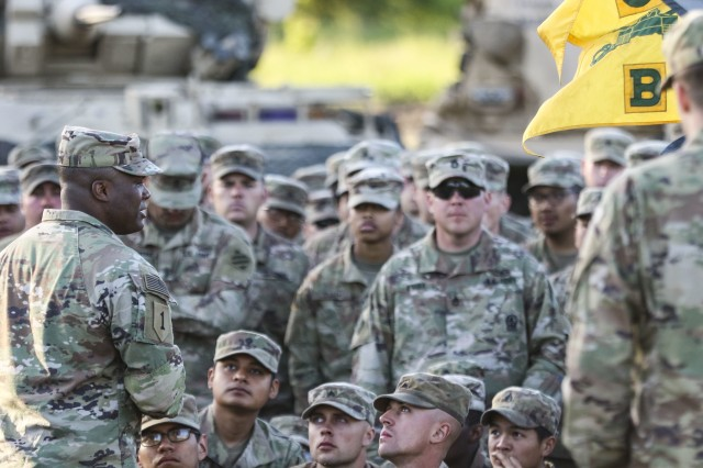 Lt. Col. George Bolton, commander of 2nd Battalion, 69th Armored Regiment, 2nd Armored Brigade Combat Team, 3rd Infantry Division, speaks to his formation after the battalion's change of command ceremony at Camp Mustang, Glebokie, Drawsko Permorkie Training Area, Poland June 1, 2020.(U.S. Army photo by Staff Sgt. Brian K. Ragin Jr.)
