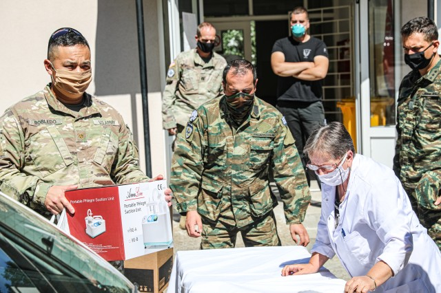 """Kosovo Force Regional-Command East Soldiers from the Liaison Monitoring Team, """"Kilo 5"""", delivered 4 thousand euros worth of medical equipment July 28, 2020 to the Health Station of Banjska (Banjske), Kosovo.  Col. Noel Hoback, RC-E deputy brigade commander, 41st Infantry Brigade Combat Team, Oregon National Guard, presided over the delivery. The Banjska (Banjske) health clinic falls within the Greek LMT's area of operations and has been identified as a major health resource to Zvecan municipality. (U.S. Army National Guard Story by Cpt. Nadine Wiley-Demoura)"""