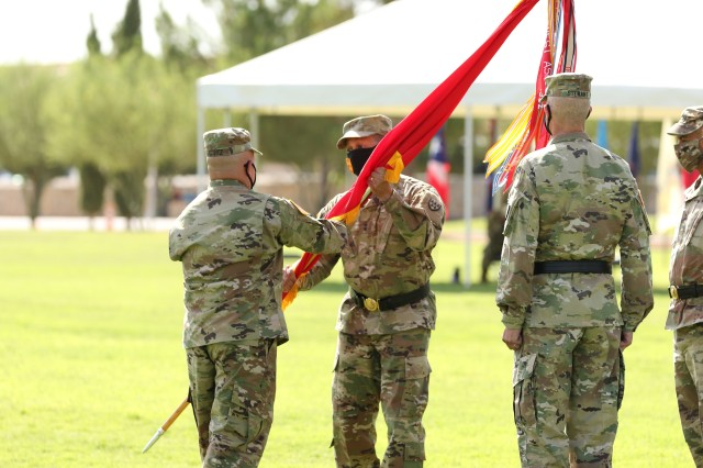 Command Sgt. Maj. Jerry J. Jacobitz (left), 32d Army Air and Missile Defense Command, passes the unit colors to Maj. Gen. Clement S. Coward, commander, 32d AAMDC, during his change of command ceremony held at Noel Parade Field, Fort Bliss, Texas, August 13, 2020.
