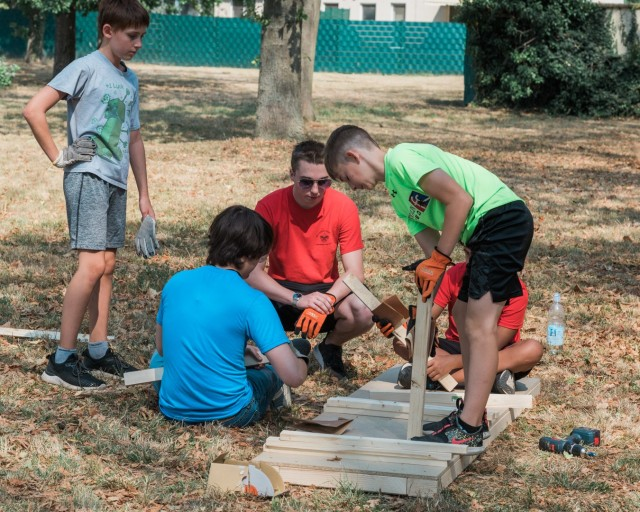 WIESBADEN, Germany - Tyler Houk (in the red shirt) works with volunteer scouts to build the platform component of the project at the dog park on Clay Kaserne Aug. 12, 2020.