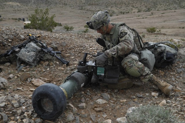 A U.S. Army Soldier assigned to 1st Stryker Brigade Combat Team, 2nd Infantry Division, Joint Base Lewis-McChord Wa., prepares his FGM-148 Javelin during Decisive Action Rotation 20-05 at the National Training Center in Fort Irwin, California, Mar. 13, 2020.  Decisive Action Rotations at the National Training Center ensure Army Brigade Combat Teams remain versatile, responsive, and consistently available for current and future contingencies (U.S. Army photo by Spc. Jessica Rutledge Operations Group, National Training Center.)