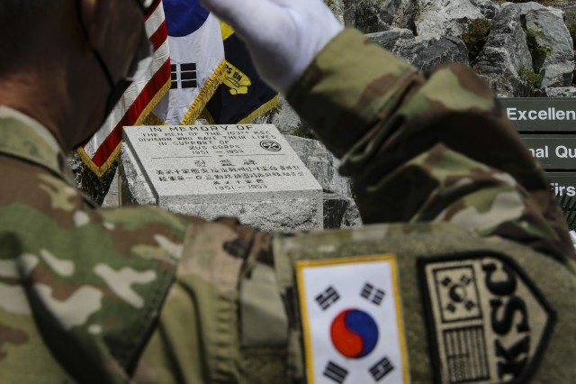 One of the 18 Korean Service Corps company commanders salutes during the playing of Taps in remembrance of the fallen KSCs at the KSC Korean War Memorial during a 70th Anniversary commemoration ceremony in Inje, South Korean, July 26, 2020. (U.S. Photo by Staff Sgt. Jacob Kohrs)