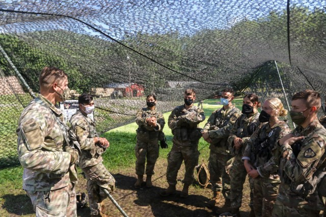 First Lt. Maylon Robertson, USMA Class of 2017, talks with Class of 2023 cadets during Cadet Field Training. Robertson, who helped run one of the call for fire lanes during the summer, was one of eight U.S. Military Academy graduates to return as part of the Cadet Summer Training task force.