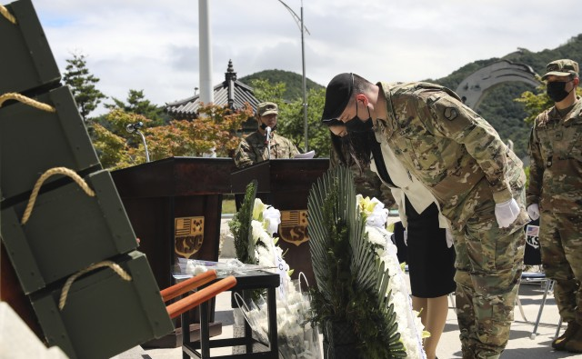 Lt. Col. John E. Cooper, commander of the Korean Service Corps, and his wife, Mrs. Jenny Cooper, bow as a cultural sign of respect in honor of the fallen KSC at the KSC Korean War Memorial during a 70th Anniversary commemoration ceremony in Inje, South Korean, July 26, 2020. (U.S. Photo by Staff Sgt. Jacob Kohrs)