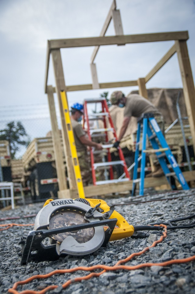 TAUNTON, Mass. – A saw sits idle on the ground as Soldiers assigned to the 338th Engineer Company prepare to construct a gazebo at the Army Reserve Center, here, Aug. 13, 2020. This construction project gave Soldiers, who aren't engineers in their civilian careers, the opportunity to practice and maintain their skills.