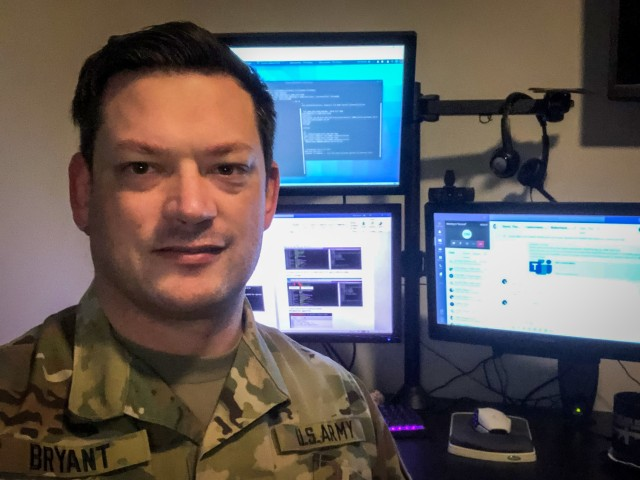 U.S. Army Reserve Lt. Col. Blake Bryant, a cyber officer with Cyber Protection Team 185 poses for a photo during his unit's Virtual Battle Assembly Aug. 9, 2020. Bryant, an assistant professor of practice at the University of Kansas, develops cybersecurity curricula as a civilian bringing those skills to the Department of Defense. (Courtesy photo)