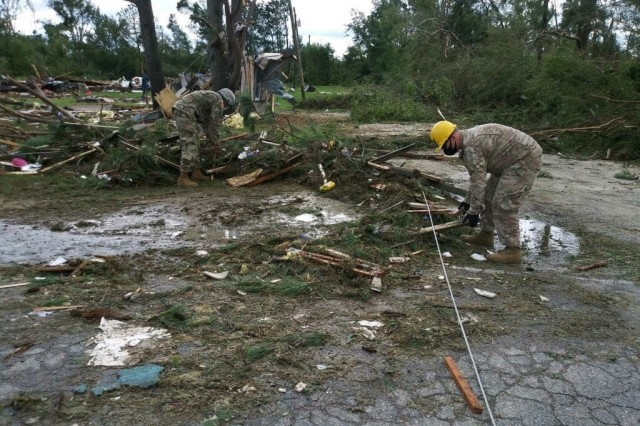 NCNG soldiers with the 105th Engineer Battalion support local first responders near Windsor, NC in the aftermath of Hurricane Isaias. A tornado destroyed a mobile home park near Windsor.