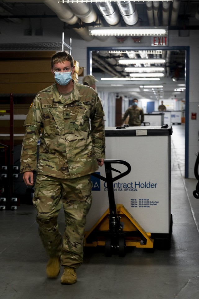 Soldiers from the Connecticut Army National Guard load a truck to deliver Covid-19 testing kits from the Governor William A. O'Neill State Armory to a storage facility in Hartford, Conn., Aug. 14, 2020. The testing kits are being stored in the facility in preparation for a potential outbreak in the fall. (U.S. Air National Guard photo by Senior Airman Chanhda Ly)