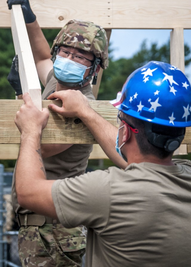 TAUNTON, Mass. – Soldiers assigned to the 338th Engineer Company construct a gazebo at the Army Reserve Center, here, Aug. 13, 2020. This construction project will help provide a shaded area for Soldiers to take breaks while working in the motor pool.