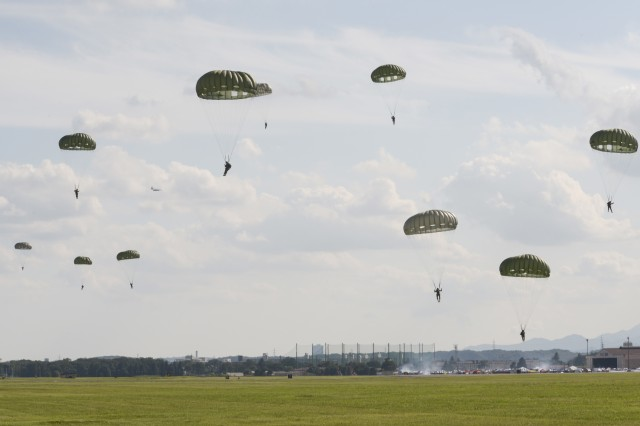 U.S. Army Soldiers with the 1st Battalion, 1st Special Operations Group (Airborne), jump from a C-130 Hercules during the 2015 Japanese-American Friendship Festival at Yokota Air Base, Japan, Sept. 19, 2015. More than 40 Soldiers jumped during the two-day festival, demonstrating Yokota's airdrop capability to the festival attendees.