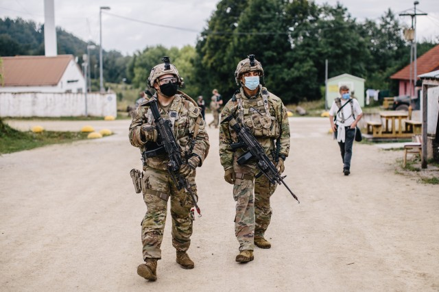 U.S Army military police soldiers assigned to the 554th MP Company, 709th MP Battalion, 18th MP Brigade patrol the streets of a notional city while supporting the 173rd Airborne Brigade during Exercise Saber Junction 20 in Hohenfels Training Area, Germany, Aug. 14, 2020.Saber Junction 20 is a 7th Army Training Command-conducted, U.S. Army Europe-directed annual exercise designed to assess the readiness of the U.S. Army's 173rd Airborne Brigade to execute unified land operations in a joint, combined environment, and to promote interoperability with participating allies and partner nations. This year's exercise will take place primarily at 7ATC's Grafenwoehr and Hohenfels Training Areas in Bavaria. U.S. military forces stationed in Europe routinely conduct these types of exercises with allied and partner nations to enhance interoperability and readiness.(U.S. Army photo by Spc. Ryan Lucas)