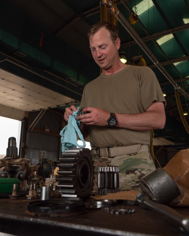 Sgt. Jason Bergstad,  41st Infantry Brigade Combat Team, Oregon National Guarda, a trained Heating, ventilation, and air conditioning (HVAC) mechanic volunteered to work on RC-E vehicles during the COVID outbreak, rebuilding a Rear Gear Hub of an M998 HMMWV on Camp Bondsteel, Kosovo July 27. (U.S. Army National Guard photo by Maj. W. Chris Clyne)