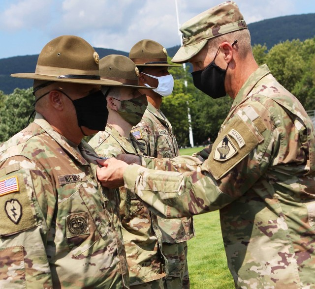 Lead drill sergeant Sgt. 1st Class Bryan Niemiec (left) and six other reserve drill sergeants from 2nd Brigade, 104th Training Division based out of Fort Lewis, Washington, receive Army Commendation medals for their work during Cadet Basic Training this summer.    U.S. Army Photo by Class of 2022 Cadet Crystal Zhang