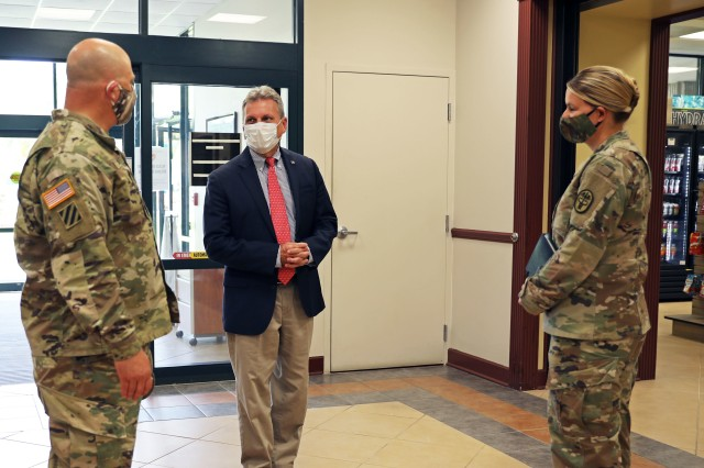 "Congressman Earl L. ""Buddy"" Carter, U.S. Representative of Georgia's 1st District, introduces himself to Col. Bryan Logan, the Fort Stewart garrison commander, and Col. Julie Freeman, the Fort Stewart MEDDAC commander, at Winn Army Community Hospital, Autg. 11 on Fort Stewart. Carter met with Fort Stewart officials to discuss new COVID-19 policies and preventative measures on the installation and in the surrounding community. (U.S. Army photo by Sgt. Zoe Garbarino)"