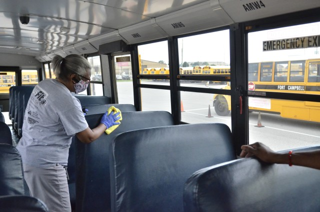 Fort Campbell Schools bus drivers and attendants, like Annie Metcalfe, will sanitize the seats of each school bus prior to every run and after every run daily. (Emily Laforme, Fort Campbell Courier )