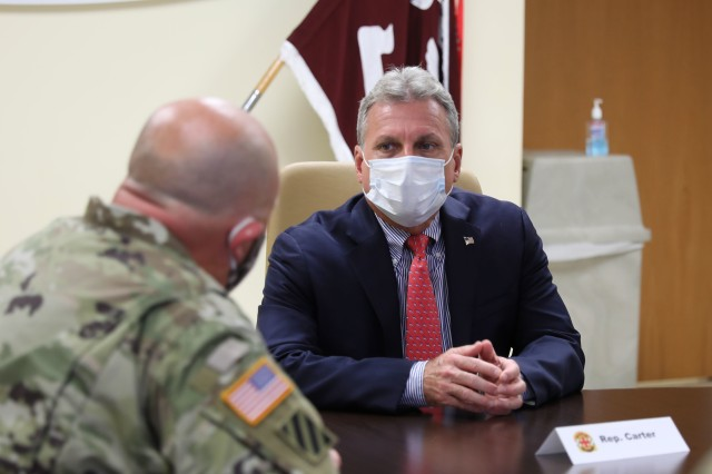 "Congressman Earl L. ""Buddy"" Carter, U.S. Representative of Georgia's 1st District, speaks to Col. Bryan Logan, the Fort Stewart garrison commander, at Winn Army Community Hospital, Aug. 11 on Fort Stewart. Carter met with Fort Stewart officials to discuss new COVID-19 policies and preventative measures on the installation and in the surrounding community. (U.S. Army photo by Sgt. Zoe Garbarino)"
