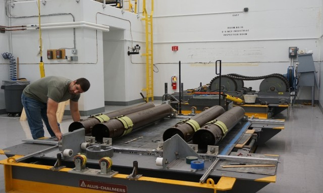 LEMC employee Nathan Hoover preparing M26 Rocket Motors for testing.