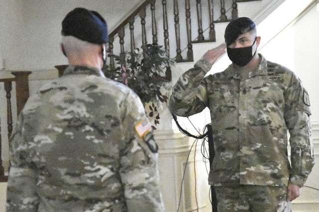 Command Sgt. Maj. Jorge Escobedo, U.S. Army Combined Arms Support Command CSM, salutes Maj. Gen. Rodney Fogg, U.S. Army CASCOM and Fort Lee commanding general, during his assumption of responsibility ceremony Aug. 19 at Fort Lee's Lee Club.