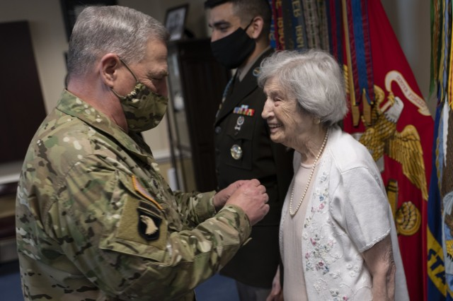 Army Gen. Mark A. Milley, chairman of the Joint Chiefs of Staff, presents World War II veteran Lt. Regina Benson with the Joint Service Achievement Medal, July 10, 2020. Benson, an Army nurse stationed in Japan and Hawaii during the war, served in dangerous conditions, endured similar horrors as her battlefield brethren, and ultimately paved the way for women like her to join the military.