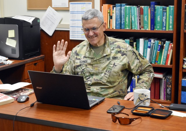 Chaplain (Maj.) Doug Ochner, deputy chaplain, U.S. Army Garrison Japan, waves farewell after presenting a Money Matters Virtual Marriage Workshop in his office at Camp Zama, Japan, Aug. 20. The Camp Zama Religious Support Office hosted the event, which also included a free dinner.