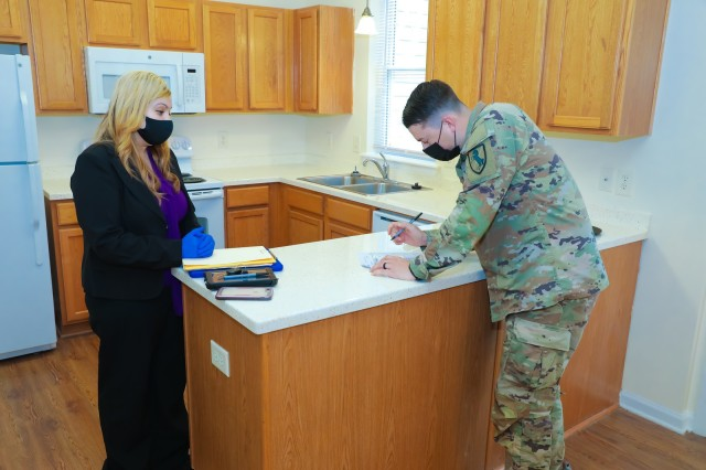 A newly assigned drill sergeant with the 199th Infantry Brigade approves a move-in inspection form at his new home on Fort Benning, Ga., June 25, 2020. Lawmakers recently passed an amendment to the Service Members Civil Relief Act, or SCRA, allowing Soldiers to terminate an auto or housing lease agreement without a 30-day notice due to a Defense Department stop-move order.