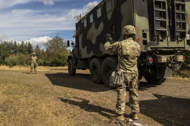U.S. Soldiers assigned to the 5th Battalion, 7th Air Defense Artillery Regiment, 10th Army Air and Missile Defense Command, ground guide a truck in Baumholder training Area, Germany on Aug. 18-20. The Swedish Armed Forces visit was to observe  training and to collaborate with the U.S. air defense artillery unit, and to discuss future training that may take place in the European theater.