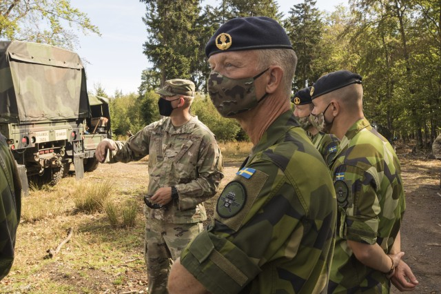 Swedish soldiers, assigned to the Air Defence Regiment, visit U.S. Soldiers assigned to the 5th Battalion, 7th Air Defense Artillery Regiment, 10th Army Air and Missile Defense Command, in Baumholder training Area, Germany on Aug. 18-20. The Swedish Armed Forces visit was to observe  training and to collaborate with the U.S. air defense artillery unit, and to discuss future training that may take place in the European theater.