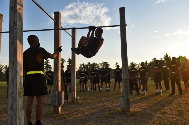 Army Reserve observer coach/trainers, assigned to the 85th U.S. Army Reserve Support Command, working under First Army's 181st Multi-functional Training Brigade, demonstrate the proper way to conduct the leg tuck, one of six test events for the Army Combat Fitness Test, during Operation Ready Warrior exercise, at Fort McCoy, Wisconsin, August 23, 2020. ORW, led by the 78th Training Division, was the Army Reserve's first collective small-scale training exercise since the start of COVID-19. The exercise was made up of partnerships from various units and organizations from the active and reserve component to include key support from the Fort McCoy Army installation that focused on COVID-19 mitigation efforts to bring Soldiers in safely to train. (U.S. Army Reserve photo by Master Sgt. Anthony L. Taylor)
