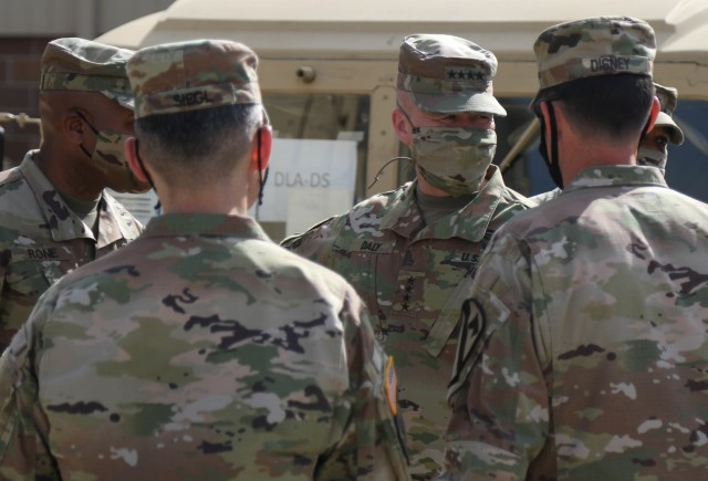 The Commanding General of the Army Materiel Command (AMC), Gen. Edward M. Daly conversates with Soldiers in the 1st Cavalry Division Sustainment Brigade's Operation Pegasus Harvest motor pool at Fort Hood, TX, July 30. The operation targets equipment readiness by reducing excess and costs. (U.S. Army photo by Pvt. Brayton Daniel)