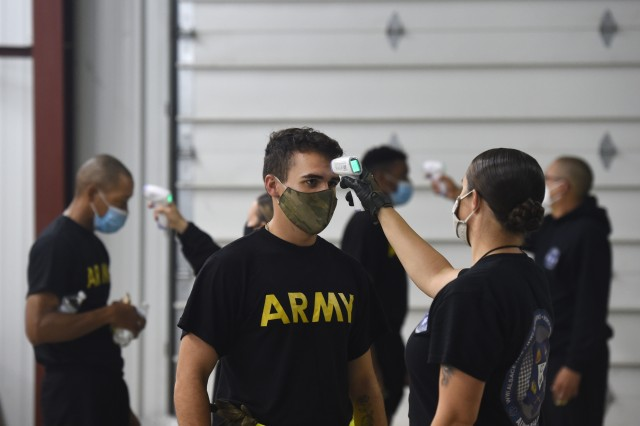 Observer coach/trainers, under First Army's 181st Multi-functional Training Brigade, conduct temperature checks on arriving Soldiers before an Army Combat Fitness Test familiarization at Operation Ready Warrior exercise, at Fort McCoy, Wisconsin, August 23, 2020. ORW, led by the 78th Training Division, was the Army Reserve's first collective small-scale training exercise since the start of COVID-19. The exercise was made up of partnerships from various units and organizations from the active and reserve component to include key support from the Fort McCoy Army installation that focused on COVID-19 mitigation efforts to bring Soldiers in safely to train. (U.S. Army Reserve photo by Master Sgt. Anthony L. Taylor)
