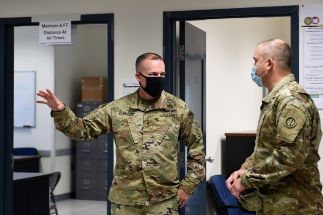 Brig. Gen. Walter Duzzny, left, commanding general of the 78th Training Division, meets with Brig. Gen. Ernest Litynski, commanding general of the 85th U.S. Army Reserve Support Command, during Operation Ready Warrior exercise, at Fort McCoy, Wisconsin, August 22, 2020. ORW, led by the 78th Training Division, was the Army Reserve's first collective small-scale training exercise since the start of COVID-19. The exercise was made up of partnerships from various units and organizations from the active and reserve component to include key support from the Fort McCoy Army installation that focused on COVID-19 mitigation efforts to bring Soldiers in safely to train. (U.S. Army Reserve photo by Master Sgt. Anthony L. Taylor)